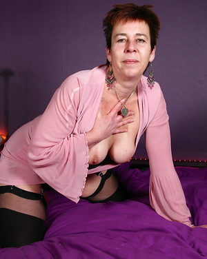 Sultry mature lady in black stockings and leather boots