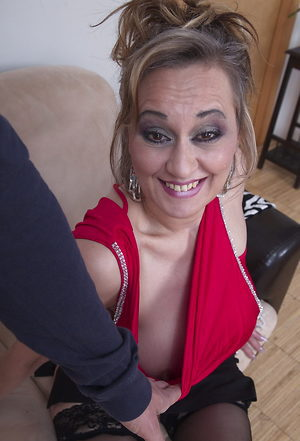 Pretty housewife shows her lovely body, ready to bite your balls