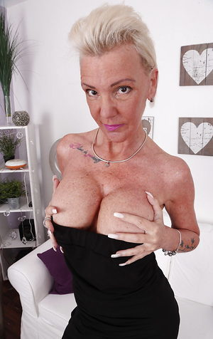 German mature chick has fantastic big fake tits