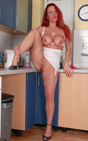 Faye Rampton - Red head on heat in the kitchen